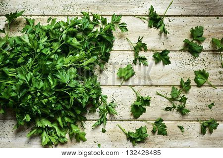 high-angle shot of a bunch of parsley on a rustic white table