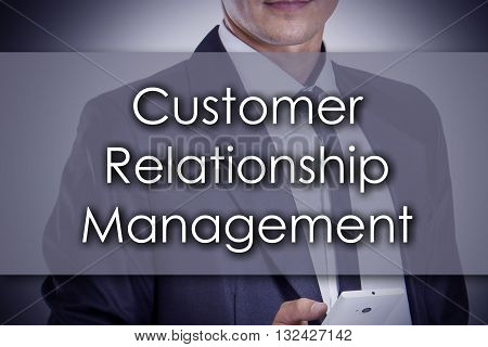 Customer Relationship Management - Young Businessman With Text - Business Concept