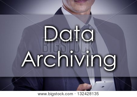Data Archiving - Young Businessman With Text - Business Concept