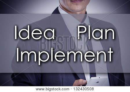 Idea - Plan - Implement - Young Businessman With Text - Business Concept