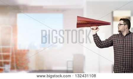 Man shouting in pape cone