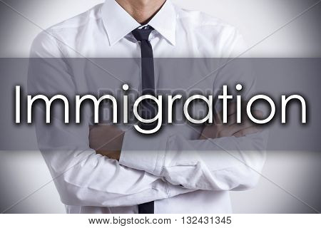 Immigration - Young Businessman With Text - Business Concept
