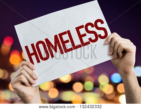 Homeless placard with night lights on background