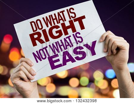 Do What is Right Not What Is Easy placard with night lights on background