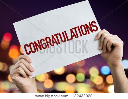 Congratulations placard with night lights on background