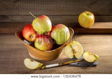 Ripe red bio apples on table. Vintage style