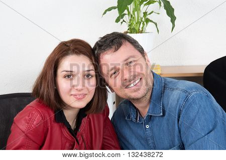 Smiling Business Woman Flirting With Man In The Office
