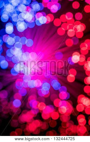 Bokeh from defocused red and blue lights from a fiber optic lamp