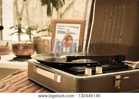 The vintage player of vinyl records retro toning