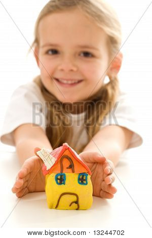 Happy Little Girl With Hand Made Clay House