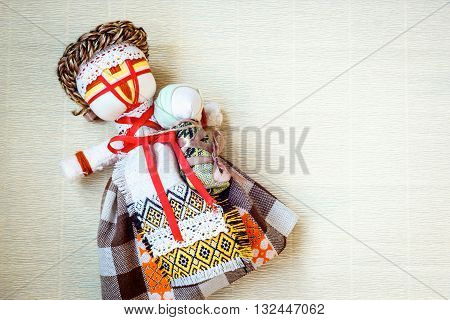 Handmade textile doll, rag doll 'Motanka' in ethnic style, ancient culture folk crafts tradition of Ukraine. Are Most Popular Souvenirs From Ukraine.