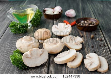 White mushrooms champignons old wooden table rustic style selective focus