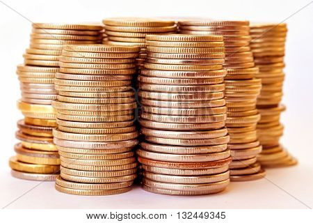 Coins stacked in bars. The concept of revenue growth