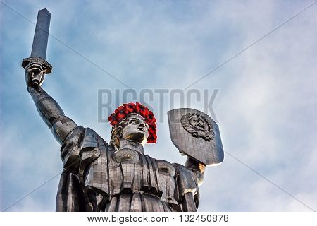 KIEV, UKRAINE - MAY 09: The Motherland Monument also known as Rodina-Mat', decorated with red poppy flower wreath on Victory Day, devoted the Great Patriotic War. May 09, 2016 in Kiev, Ukraine