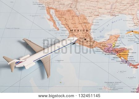 Passenger Plane On The Map With Destination Mexico
