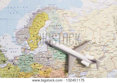 Travel Destination Scandinavia. Passenger Plane Miniature Over The Map