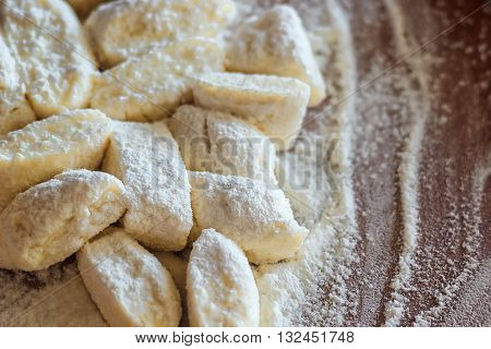 Ukrainian traditional lazy dumplings with cottage cheese. Belarusian and Ukrainian Cuisine. Process of making homemade dumplings on a floured board.,delicious lunch.