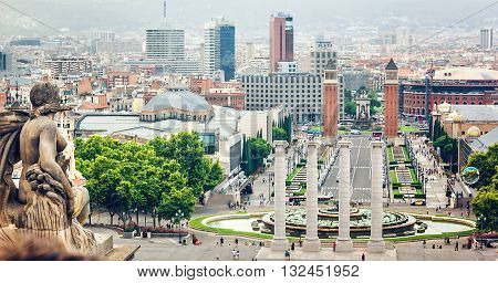 BARCELONA, SPAIN - View from Montjuic to Plaza de Espana (Plaza d'Espanya) including the four columns and the Venetian towers in Barcelona, Spain.
