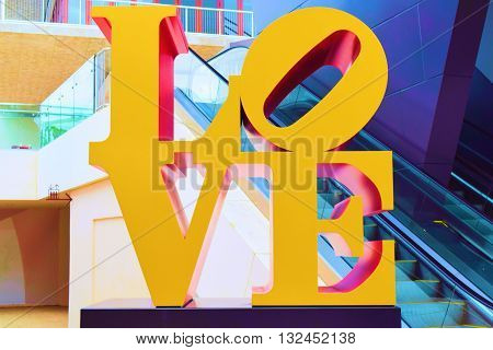 May 20, 2016 in Miami, FL:  Art sculpture of letters which says Love at Palm Court in the Miami Design District where people enjoy shopping at retail stores and dining at restaurants taken in Miami, FL