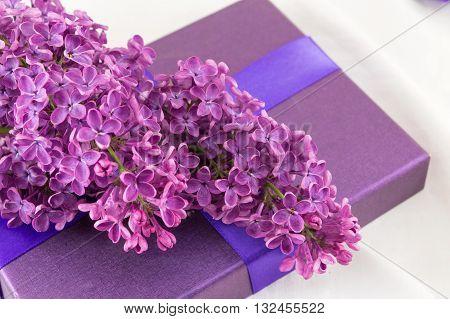 Purple Lilac Flowers On A Present Box