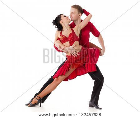 Dancing young couple on a white background.