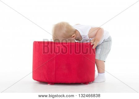 Sweet small baby playing with box on a white background.