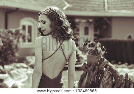 Pretty young woman wearing a formal dress