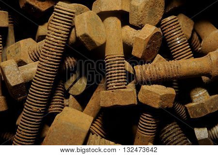 Group of many Rusty nuts and bolts