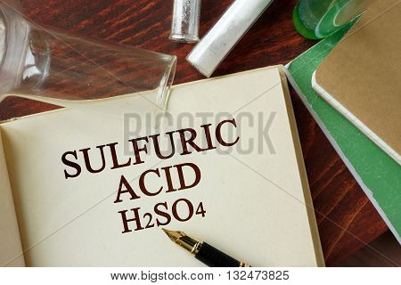 Words sulfuric acid written on a page. Chemistry concept.