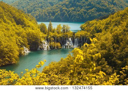 Beautiful landscape, waterfall and clear green water in the Plitvice Lakes National Park in Croatia, beautiful world. Warm vibrant colors.