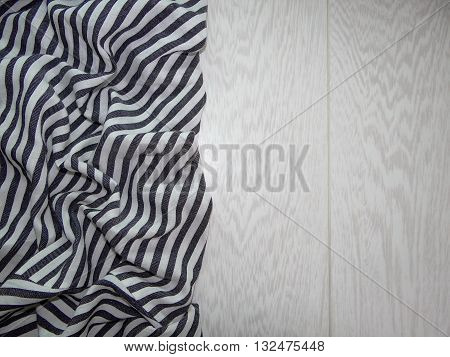 striped fabric laid in the crease on wooden boards