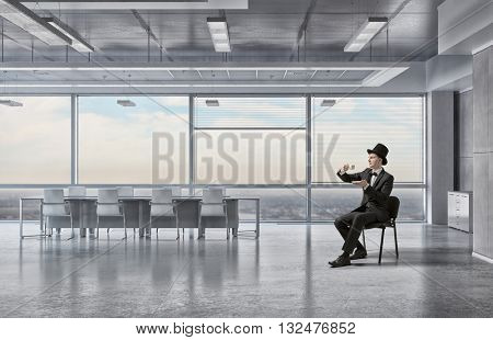 Businessman in cylinder drinking coffee