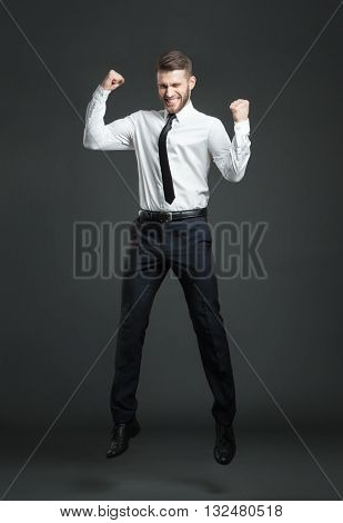 Handsome Young Businessman Celebrating His Success.