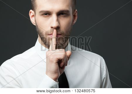 Portrait Of Young Handsome Businessman Gesturing