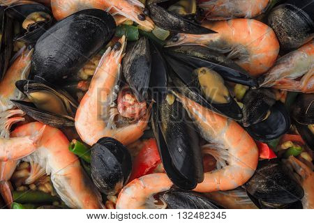 Paella with seafood background close-up horizontal, texture, close-up