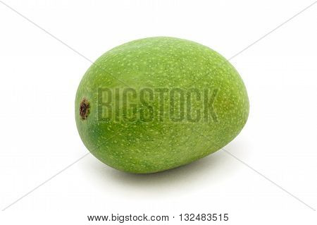 An Organic green Indian Mango (Mangifera indica) isolated on white background. Front view.