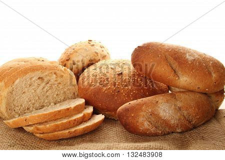 A lot of different breads are on sackcloth. isolate