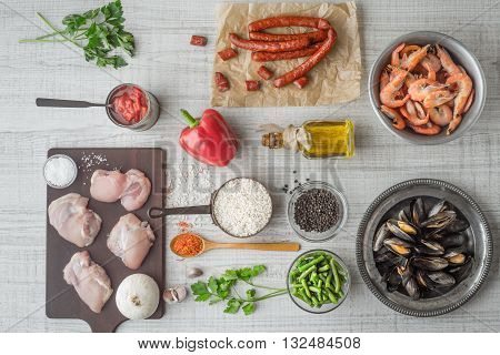 Ingredients for paella on the white table horizontal
