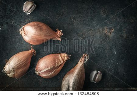Shallots on the old metal background top view