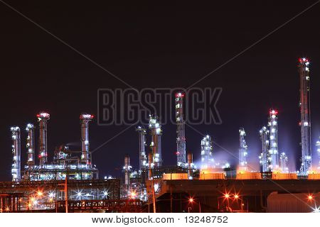 beautiful scenic of petrochemical oil refinery plant shines at night closeup
