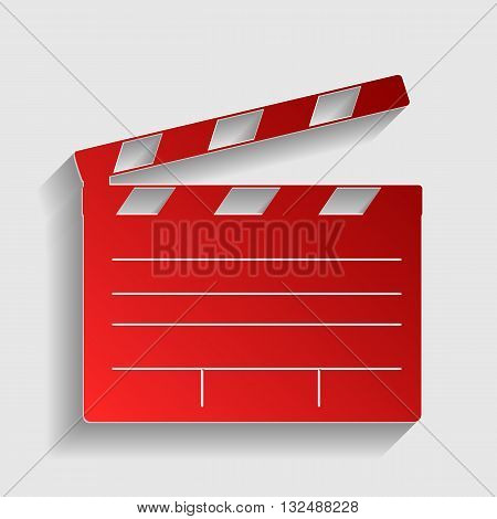 Film clap board cinema sign. Red paper style icon with shadow on gray.