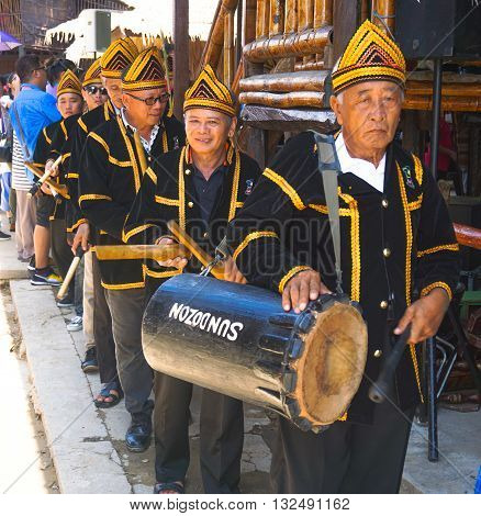 Penampang,Sabah-May 31,2016:Group of Kadazandusun ready for perform playing gong during Sabah Harvest festival celebration in Kota Kinabalu, Sabah Borneo, Malaysia.