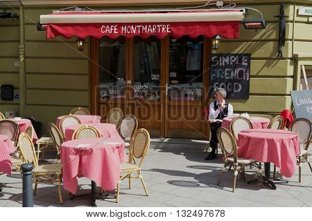 VILNIUS, LITHUANIA - MAY 02, 2015: Unidentified man sits at the table at the Cafe Montmartre in downtown Vilnius, Lithuania.