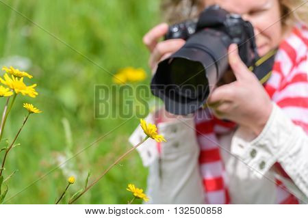 image of a woman taking pictures with a SLR camera