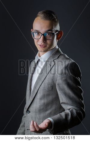 Young Stylish Guy In Glasses Talking