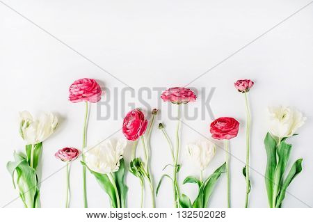 Pink and white roses or ranunculus isolated on white background. Flat lay top view