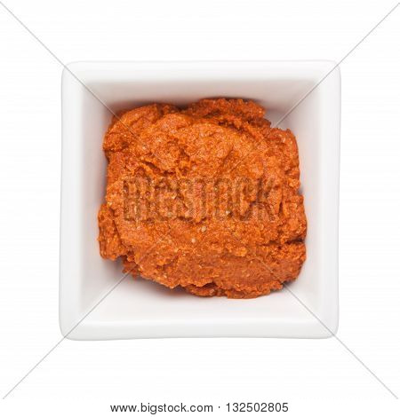 Chili paste in a square bowl isolated on white background