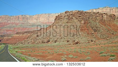 the highway passes along the base of the Vermillion Cliffs in northern Arizona