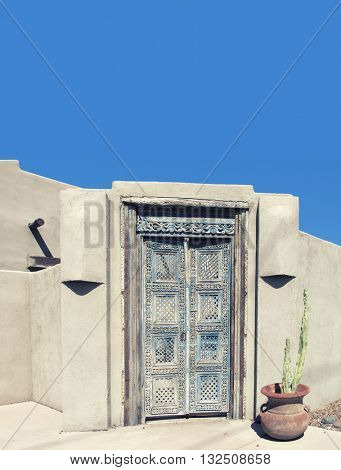 Desert Southwest stucco all and ornate doorway