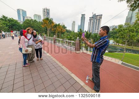 People Photographing In City Centre Park, Kuala Lumpur, Malaysia